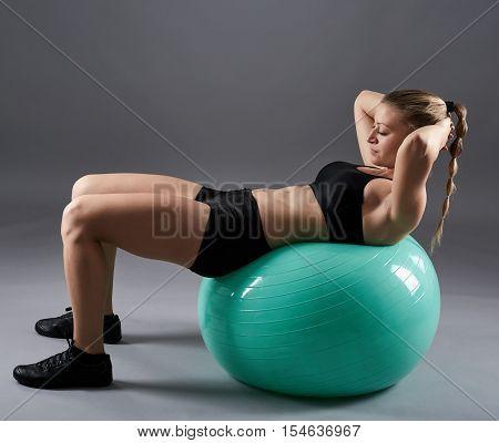 Woman Doing Abs On Gym Ball