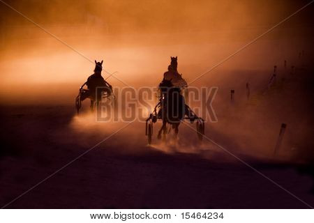 training trotters race in arena in dusk, Belgrade hippodrome
