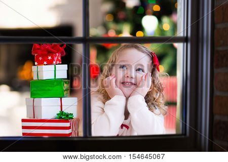 Child Watching Out Of Window On Christmas Eve