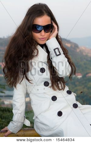 young beautiful brunette woman with sunglasses
