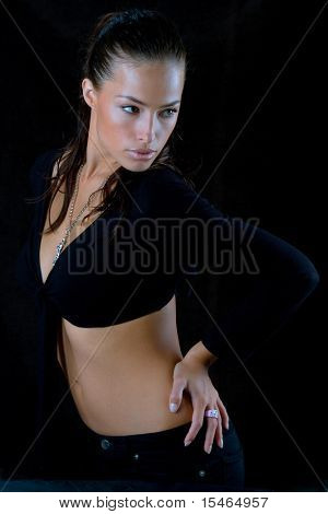 woman in dancing pose, studio shot