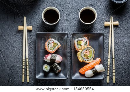 Closeup of sushi for two people on black rock