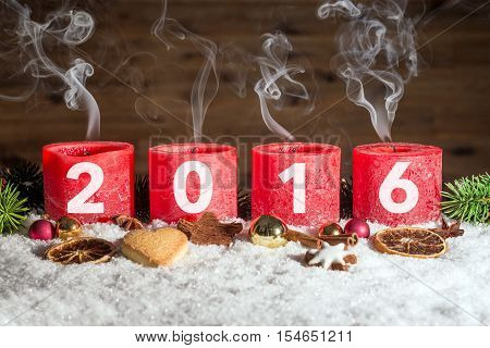 Four Blown Out Advent Candles With 2016 In Snow