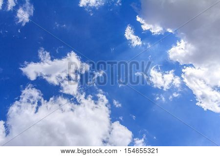 Blue sky with white clouds. The vast blue sky and clouds sky on sunny day. White fluffy clouds in the blue sky.