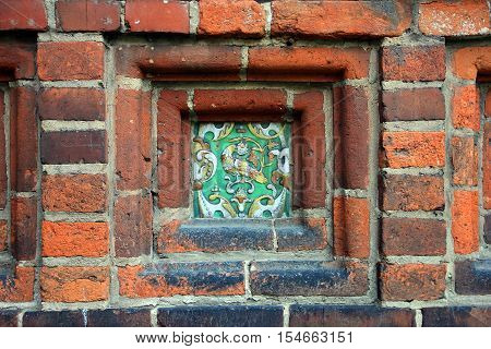 building wall decoration in the form of decorative glazed ceramic picture ceramic ornament closeup