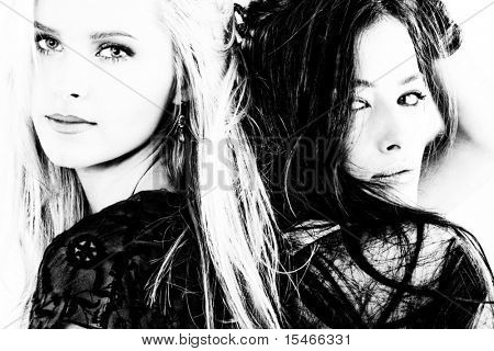 couple of women blond and brunette portrait in black and white
