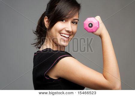 pretty teen girl workout with hand waight, studio shot