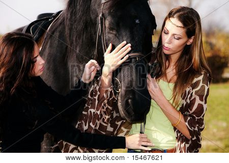 two young woman with horse