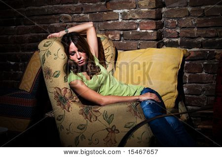 young woman  sit in armchair feeling depressed, indoor shot