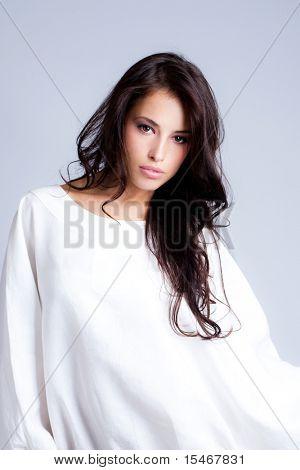 sensual longhair brunette in white, studio shot