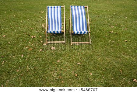 two lonely striped chairs on the park