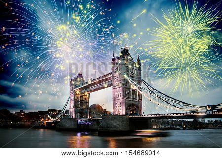 Tower bridge with fireworks, celebration of the New Year in London, UK