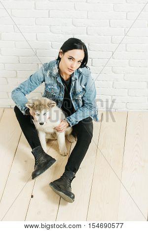 Girl In Denim With Husky