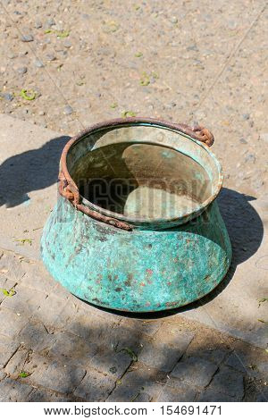 Selling old metal cookware in bazaar on ground