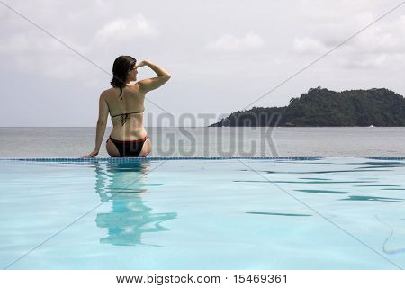 woman looking at the view, enjoying the paradise