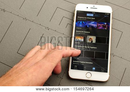 PARIS FRANCE - SEPT 26 2016: New iPhone 7 Plus with hand touching screen to sign-in to WWDC app. iPhone 7 and iPhone 7 plus is the most wanted phone worldwide