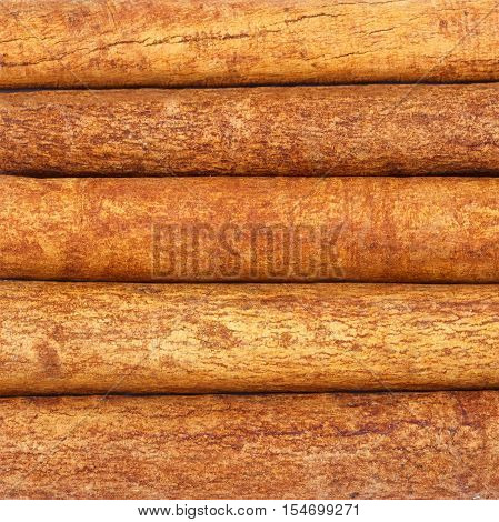 Background of cinnamon sticks top view close-up