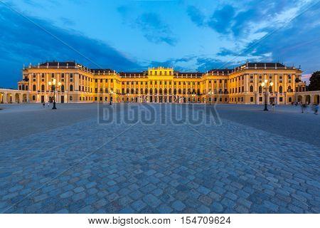 VIENNA AUSTRIA - JULY 24: Schonbrunn Palace Vienna Austria at dusk on JULY 24, 2015. Schonbrunn Palace  is a former imperial summer residence located in Vienna, Austria.