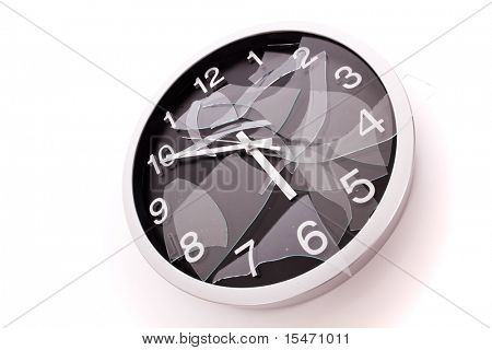 broken wall clock over a white background