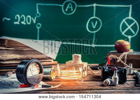 Electrical experience in physics laboratory on old wooden table