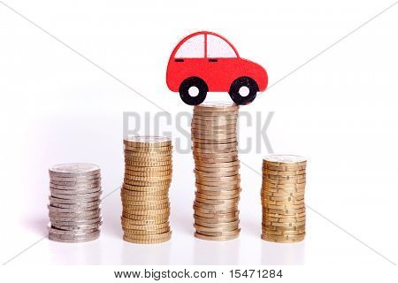 red car over a lot of stacked coins