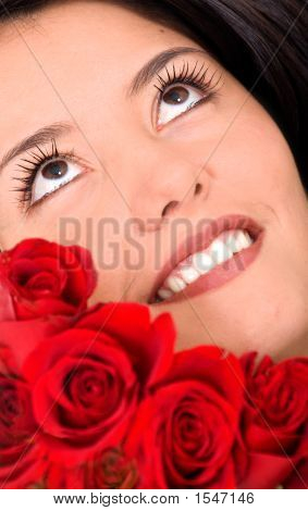 Beauty Portrait Of A Girl With Roses