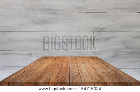 Perspective brown table top with white wooden wall background, stock photo