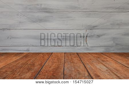 Perspective table top with white wooden wall background, stock photo