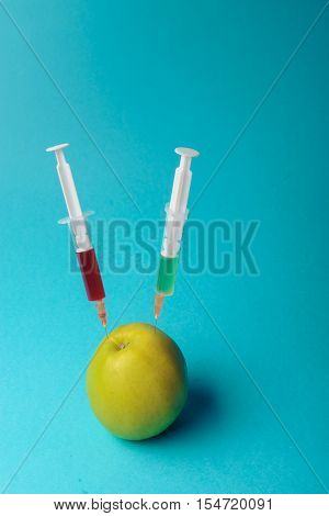 Chemical Additives In Food Or Genetically Modified Fruit Concept.