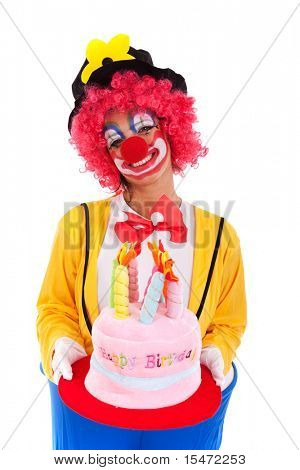 funny clown holding a birthday cake hat (isolated on white)