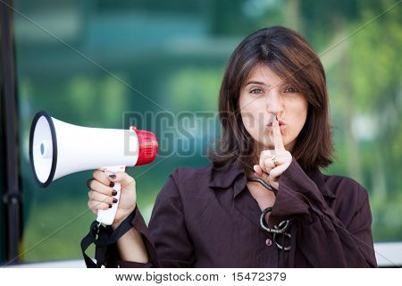 businesswoman telling you to make silence