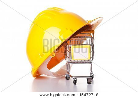 construction helmet over a shopping cart (isolated on white)