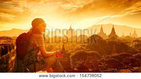 poster of Young traveller enjoying a looking at sunset on Bagan Myanmar Asia. Traveling along Asia active lifestyle concept