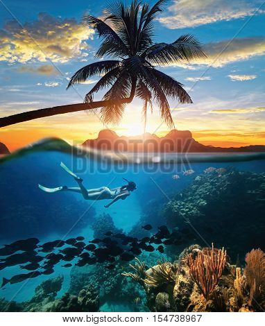 Young woman snorkeling near the coral reef in the tropical Caribian sea on sunset day.