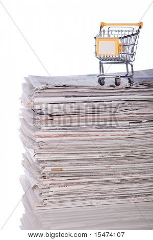 Shopping cart to buy the latest news (selective focus)