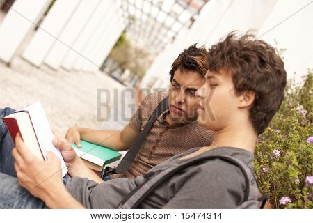 two young student reading books at the school (selective focus)