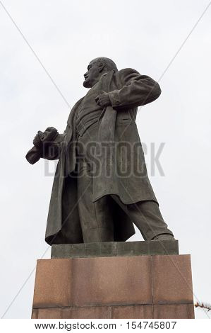 the monument to Lenin is a view from below against the sky