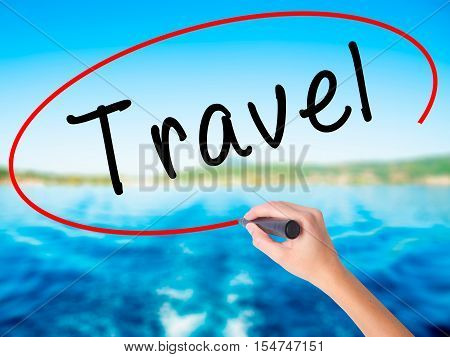 Woman Hand Writing Travel  With A Marker Over Transparent Board