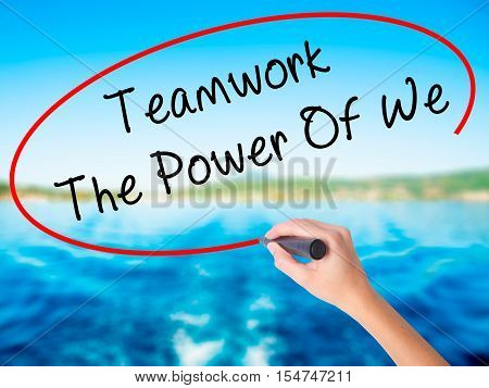 Woman Hand Writing Teamwork - The Power Of We With A Marker Over Transparent Board