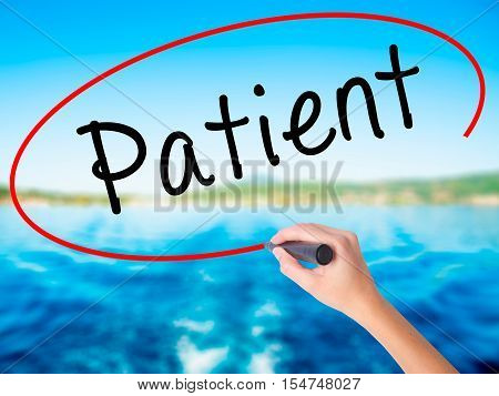 Woman Hand Writing Patient With A Marker Over Transparent Board