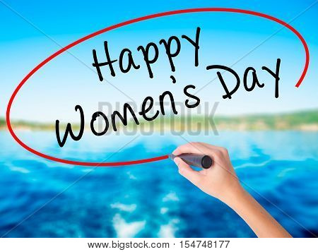 Woman Hand Writing Happy Women's Day With A Marker Over Transparent Board