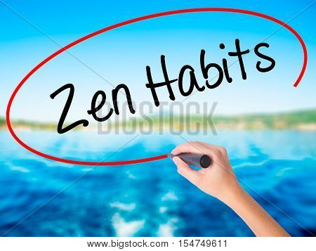 Woman Hand Writing Zen Habits With A Marker Over Transparent Board