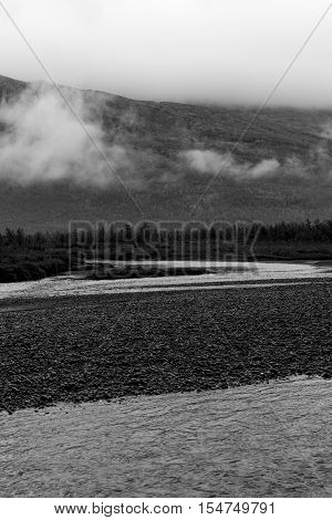 Clouds, forest, rivers are part of the beautiful landscape of Sarek, Sweden