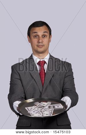 businessman serving you money on a plate