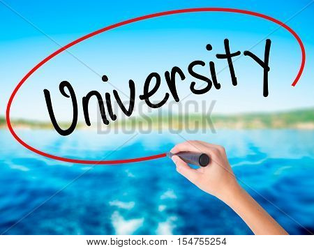 Woman Hand Writing University With A Marker Over Transparent Board