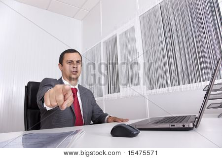 Bossy mature businessman at the office pointing to you
