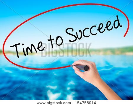 Woman Hand Writing Time To Succeed With A Marker Over Transparent Board