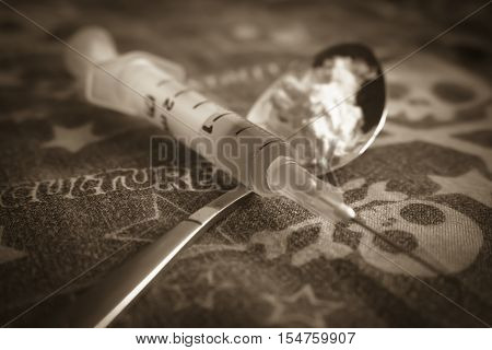 Training spoon, the syringe and cooked heroin. To stop the use of Drugs.Injection, illicit drugs, doping.