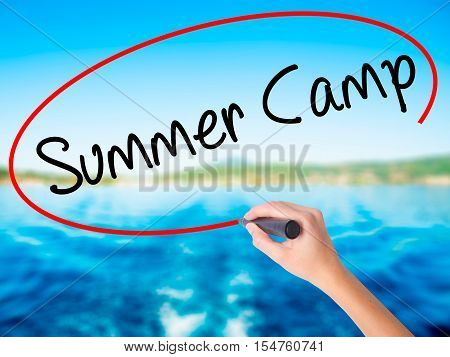 Woman Hand Writing Summer Camp With A Marker Over Transparent Board