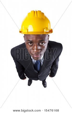 Powerful and happy african engineer businessman looking up (isolated on white)